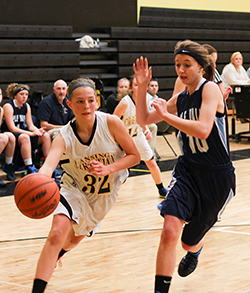 Lansing Christian School athlete Kasey dribbling around her opponent