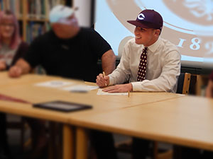 Lansing Christian School Senior Josh Parks signs to play baseball at the University of Chicago
