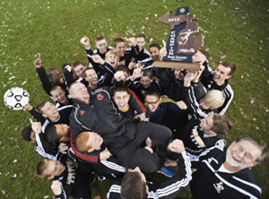 Lansing Christian School boys' soccer team after their historic regional win