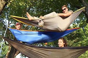 Lansing Christian High School students in hammocks at the 2015 retreat.