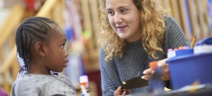 Lansing Christian School senior working with a kindergartener