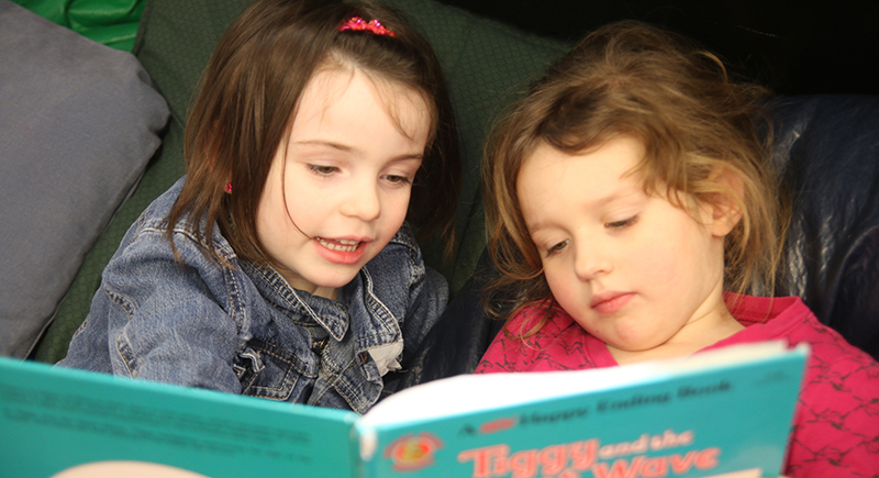 Daycare students reading together