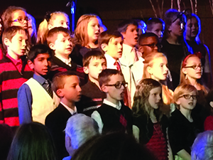 Lansing Christian Elementary School students sing at the Getty concert