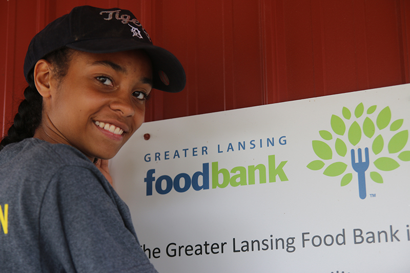 A Lansing Christian School student working at the Greater Lansing Food Bank