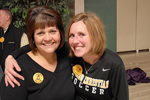 Lisa (Hill) Iverson and Heidi (DeVries) Hay at Lansing Christian School Homecoming