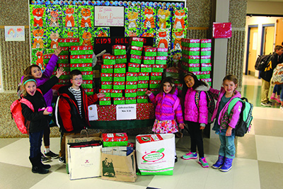 Lansing Christian Elementary School students with the boxes they collected for Operation Christmas Child