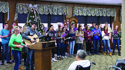 Lansing Christian School Spanish class performing at a retirement center