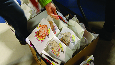 Lansing Christian School students making sandwiches for students at a local elementary