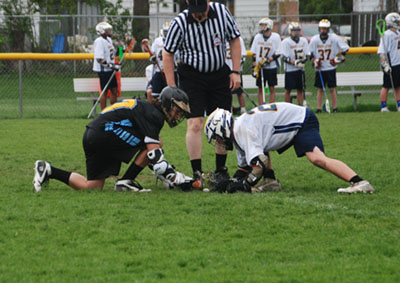 A player from the Lansing Christian/Waverly School co-op team faces off with an opponent
