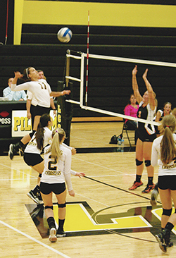 Lansing Christian School volleyball player Cassie prepares to slam ball