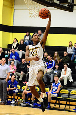 Lansing Christian School Senior Forrest Bouyer goes in for the lay up