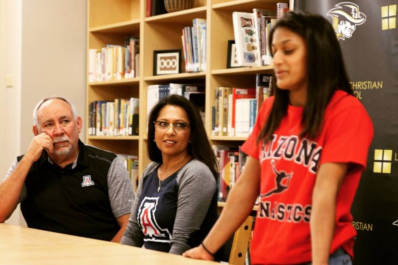 Earlier today, with her proud parents by her side and her fellow students applauding, Asia signed her commitment to compete for the University of Arizona gymnastics team next year. Congratulations for this amazing accomplishment, Asia! It's a testament to your hard work and the incredible support of your family. #Lcs_Excels #LCSgram