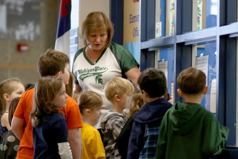 """Mrs. Person took her kindergarten class on a """"door tour"""" of the elementary hallways. Classes decorated their doors as different books for #MarchIsReadingMonth and then visited all the other classroom doors. #LCS_community https://www.lansingchristianschool.org"""