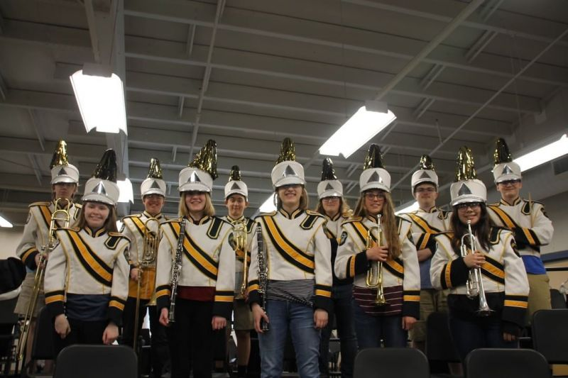 LCS band students proudly model the plumes that were purchased as a gift for the marching band! www.lansingchristianschool.org